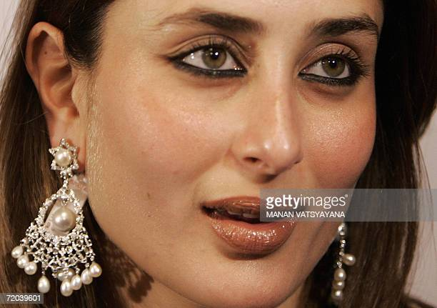 Indian actress Kareena Kapoor poses for media during a display of the exclusive jewellery brand Intrea's fallwinter 2006 collection in New Delhi 29...
