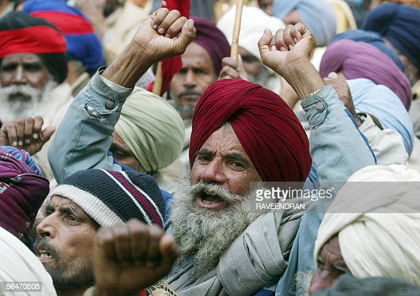 Indian agriculture workers shout antigovernment slogans during a demonstration in New Delhi 20 December 2005 Hundreds of workers staged a protest and...
