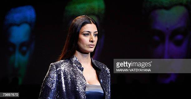 Indian Bollywood Actress Tabu displays a creation by Indian designer Rajesh Pratap Singh during the Grand finale of Wills India Fashion Week in New...
