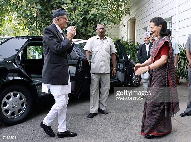 Indian Congress President Sonia Gandhi greets Nepalese Prime Minister Girija Prasad Koirala prior to a meeting in New Delhi 08 June 2006 Indian Prime...