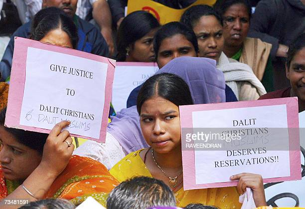 Indian Dalit Christian and Muslim women hold placards and shout slogans during a rally against the National Commission for Scheduled Castes and...