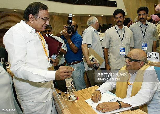 Indian Finance Minister P Chidambaram gestures as he talks with Tamil Nadu Chief Minister M Karunanidhi during the 53rd meeting of the National...