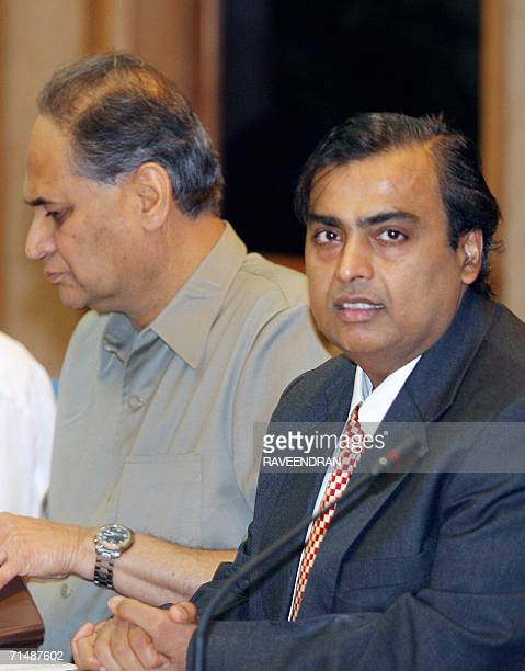 Indian head of Reliance Industries Mukesh Ambani and Chairman of Bajaj group Rahul Bajaj attend a meeting of Indian industrialists at Prime Minister...
