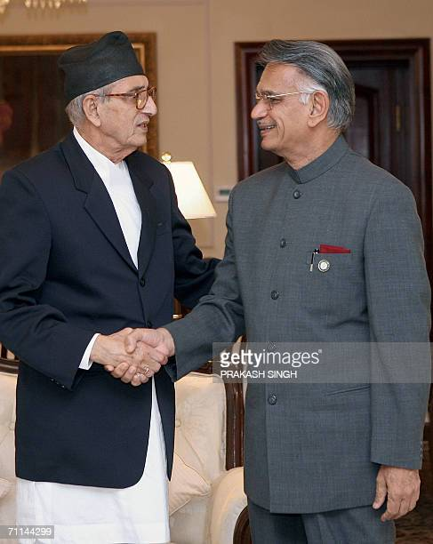 Indian Home Minister Shivraj Patil shakes hands with Nepalese Prime Minister Girija Prasad Koirala prior to a meeting in New Delhi 07 June 2006...