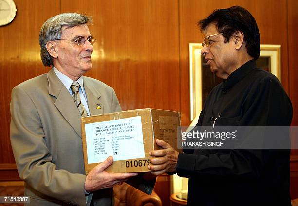 Indian Minister of State for External Affairs E Ahmed presents a box of medicine as a symbolic gesture of Indian medical aid to the Ambassador of...