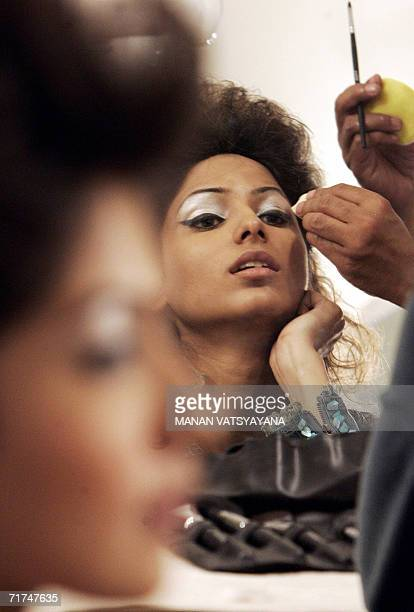 Indian models get their makeup done for Indian designer Rohit Bal's fashion presentation on the opening day of the Wills Lifestyle Fashion Week in...