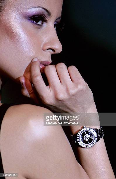Indian models pose with newly launched Christian Dior Christal range watches in New Delhi, 24 May 2007. The new Dior Christal range of watches...