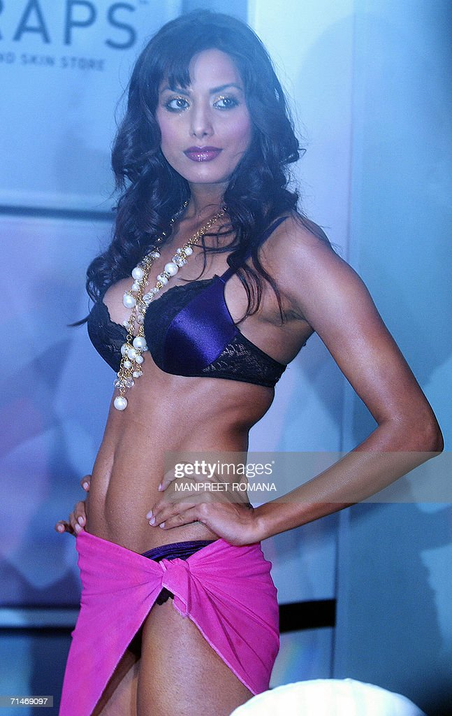 Indian models present lingerie during th pictures getty images indian models present lingerie during the launch of a new line by oswal in new delhi voltagebd Image collections