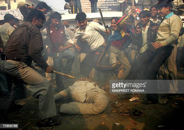 Indian Muslims beat an effigy of US President George Bush during a protest in New Delhi 31 December 2006 against the execution of former Iraqi...
