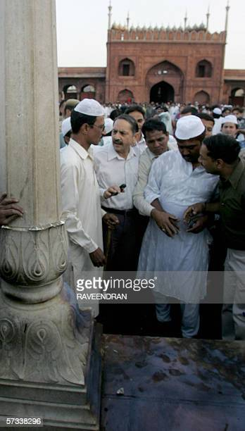 Indian Muslims gather at a blast site inside the Jama Masjid in New Delhi 14 April 2006 after twin blasts struck India's largest mosque Women and...