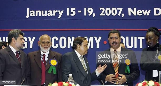 Indian Petrolium Minister Murli Deora gestures while posing with Vice President of Petroleos de Venezuela SA Luis F Vierma Sri Lanka's Minister of...
