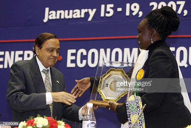 Indian Petrolium Minister Murli Deora presents a memento to Sudan's Minister of State for Petroleum and Mineral Resources Angelina Teny during the...
