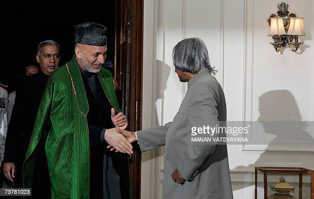 Indian President APJAbdul Kalam welcomes Afghan President Hamid Karzai for a meeting at the Presidential Palace in New Delhi 03 April 2007 on the...