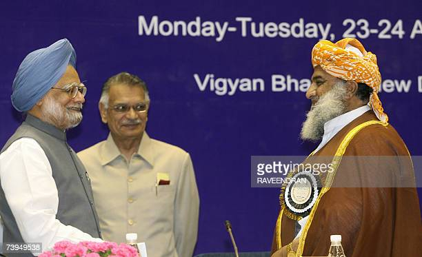 Indian Prime Minister Manmohan Singh is watched by Indian Home Minister Shivraj Patil as he speaks with Pakistan National Assembly Opposition Leader...