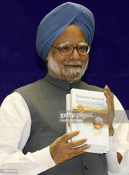 Indian Prime Minister Manmohan Singh psoes as he releases a book entitled 'Parliamentary Speeches of Maulana Syed Asad Madani' during a Fidaemillat...