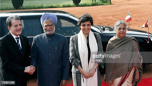 Indian Prime Minister Manmohan Singh shakes hands with Italian Prime Minister Romano Prodi as Prodi's Wife Flavia Franzoni and Singh's Wife Gurcharan...