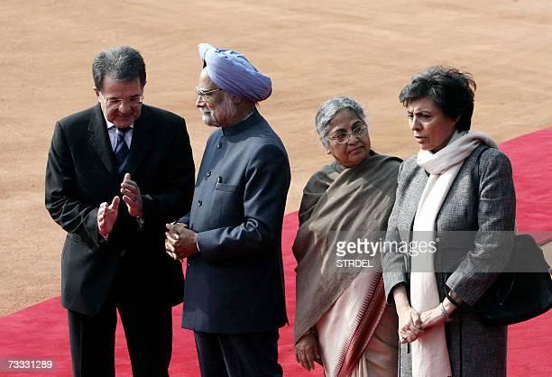 Indian Prime Minister Manmohan Singh talks with Italian Prime Minister Romano Prodi as Prodi's Wife Flavia Franzoni and Singh's Wife Gurcharan Kaur...