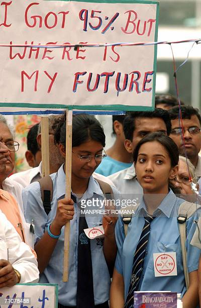Indian school children carry placards as they join in protests at The All Indian Insitute of Medical Sciences in New Delhi 30 May 2006 against the...