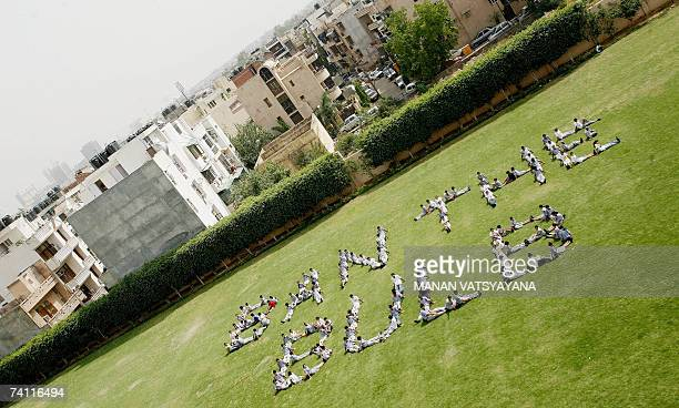 Indian schoolchildren make a humanformation reading Ban the Bulb in New Delhi 10 May 2007 as part of Greenpeace campaign to ban incandescent bulbs...