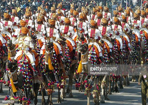 Indian soldiers from the Border Security Force ride camels during a full dress rehearsal for India's upcoming Republic Day parade in New Delhi 23...