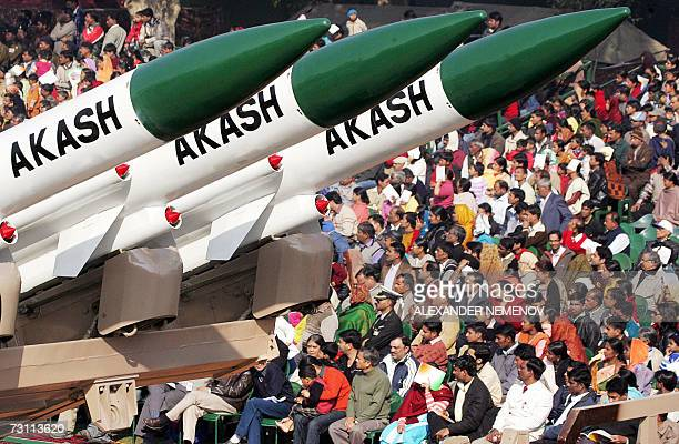 Indian spectators watch as shortrange Akash missiles are displayed during the Republic Day celebrations in New Delhi 26 January 2007 Russian...