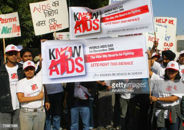 Indian students and youths hold placards and shout slogans during a procession held to mark World AIDS Day in New Delhi 01 December 2006 on the...
