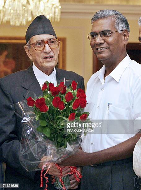 India's Communist Party of India leader D Raja presents a bouquet to Nepal's Prime Minister Girija Prasad Koirala during a meeting in New Delhi 08...
