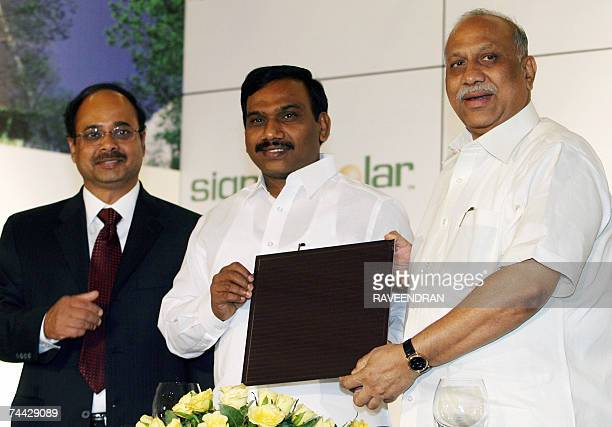 India's new Information and Technology Minister A Raja Indian Minister of State for NonConventional Energy Sources Vilas Muttemwar hold a Signet...
