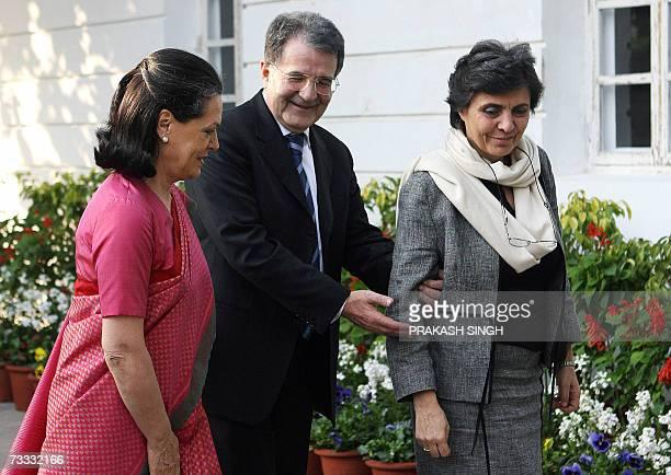 Italian Prime Minister Romano Prodi gestures as he talks with India's United Progressive Alliance Government Chairperson Sonia Gandhi as his wife...