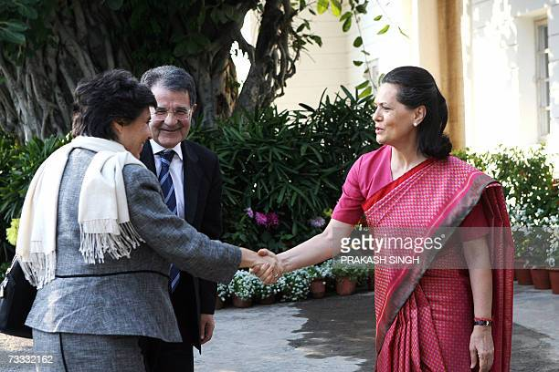 Italian Prime Minister Romano Prodi looks on as India's United Progressive Alliance Government Chairperson Sonia Gandhi shakes hands with his wife...