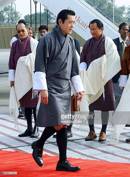 King of Bhutan Jigme Khesar Namgyel Wangchuck walks by officials of the Bhutanese embassy upon his arrival at the Indira Gandhi International Airport...