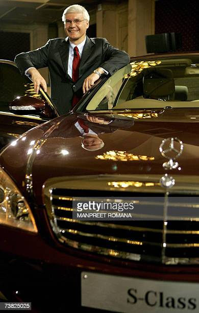 Managing Director and Chief Executive Officer of DaimlerChrysler India Wilfried G Aulbur poses for a photograph with SClass S320 CDi L during a press...