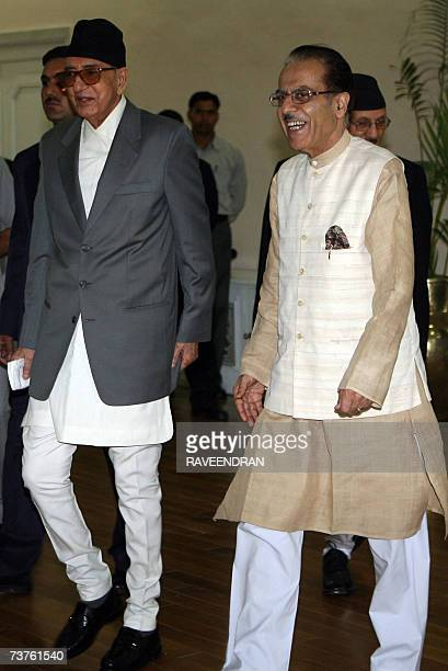 Nepalese Prime Minister Girija Prasad Koirala walks with Indian Water Minister Saifuddin Soz after his arrival at Indira Gandhi International Airport...