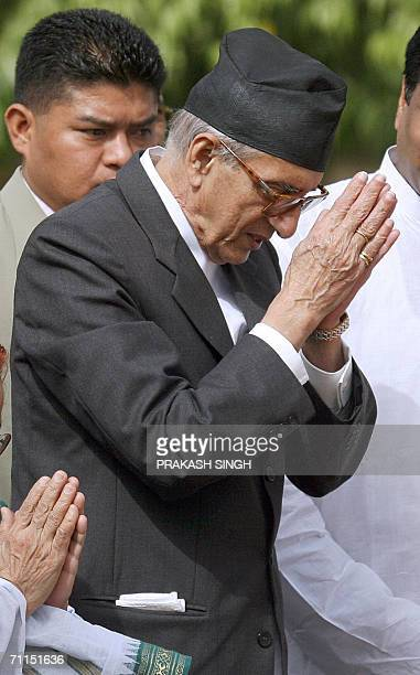 Nepal's Prime Minister Girija Prasad Koirala pays tribute at the 'Rajghat' the memorial of the late Mahatma Gandhi in New Delhi 08 June 2006 India's...