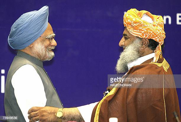 Pakistan National Assembly Opposition Leader Maulana Fazalur Rehman embraces Indian Prime Minister Manmohan Singh at a Fidaemillat Seminar organized...