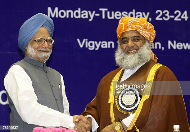 Pakistan National Assembly Opposition Leader Maulana Fazalur Rehman shakes hands with Indian Prime Minister Manmohan Singh at a Fidaemillat Seminar...
