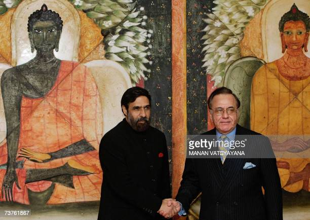 Pakistani Foreign Minister Khurshid Mehmood Kasuri shakes hands with Indian Minister of State for External Affairs Anand Sharma after his arrival at...