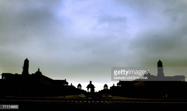 Pre-monsoon clouds loom over the President house in New Delhi, 03 June 2006. The death toll from lightning strikes and powerful storms rose to 105 as...