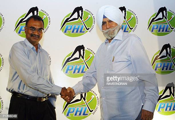 President of The Indian Hockey Federation KPS Gill shakes hands with Managing Director ESPN Software India RC Venkateish during a press conference in...
