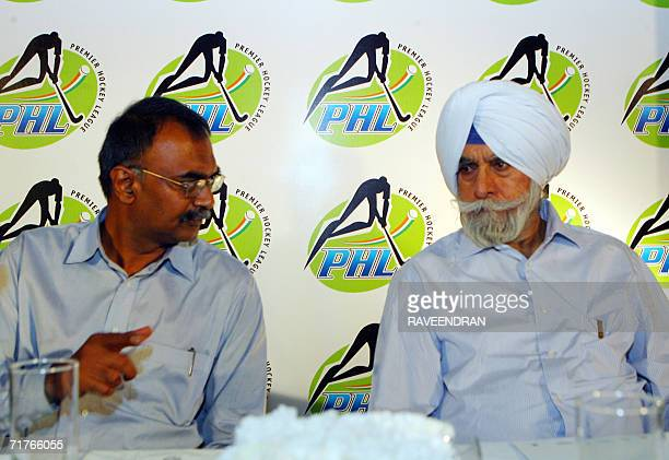 President of The Indian Hockey Federation KPS Gill speaks with Managing Director ESPN Software India RC Venkateish during a press conference in New...