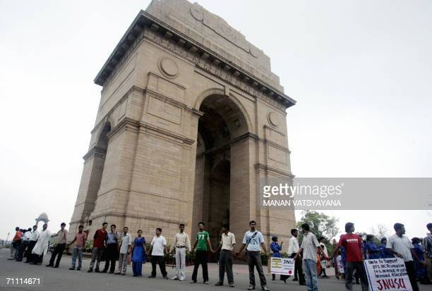 Pro-reservation activists hold placards and shout slogans as they make human-chain during a demonstration at the India Gate in New Delhi, 03 June...