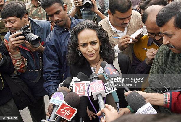 Renowned Indian writer and social activist Arundhati Roy talks to reporters as she along with activists of the National Alliance of People's Movement...