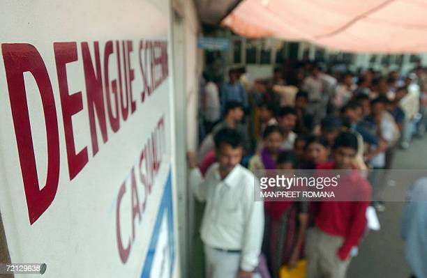Suspected Indian dengue patients stand in a line outside a dengue screening ward at The All India Institute of Medical Sciences Hospital in New Delhi...