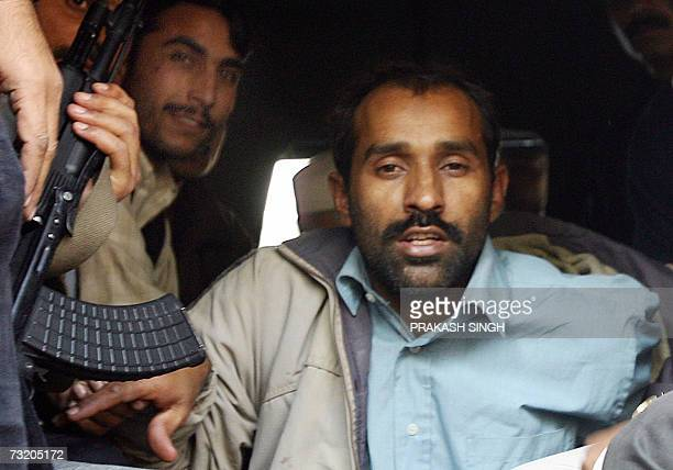 Suspected JaisheMohammad militant Shahid Gaffoor from Sialkot in Pakistan is shown in custody of Delhi Police's Special Cell officials in New Delhi...
