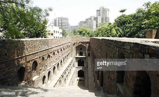 The skyscrapers of the central district are seen in the background behind the Ugrasen-Ki-Baoli step-well in New Delhi, 24 April 2007....