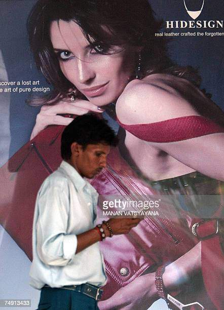 TO GO WITH STORY 'LIFESTYLEINDIARETAILFASHIONCOMPANYHIDESIGN' An Indian man walks past an advertising hoarding outside the Hidesign showroom in New...