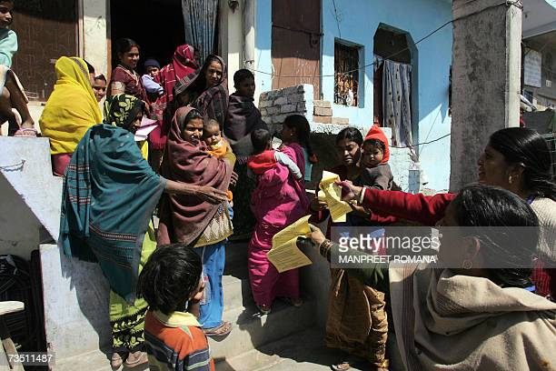 TO GO WITH WomenIndiaabusesched Indian women distribute pamphlets before they take part in a street march against sexual harassment and marital...