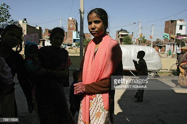 TO GO WITH WomenIndiaabusesched Sixteenyearold school girl Rekha poses for a photograph during a street march against sexual harassment and marital...