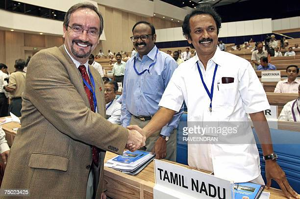 United Nations Children's Fund Deputy Director Programmes Emar Barr shakes hands with Tamil Nadu's Local Administration and Water Minister M K Stalin...
