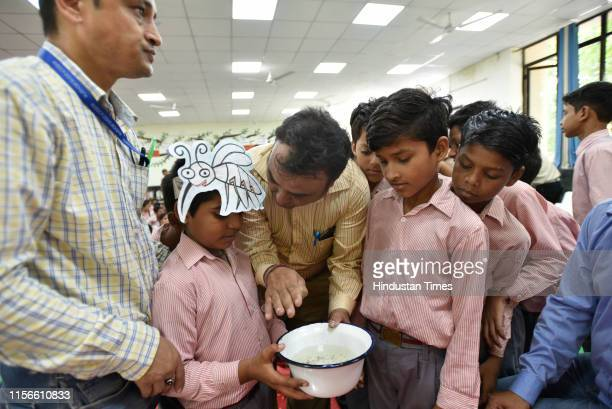 New Delhi Municipal Council officials demonstrate identification and prevention processes for vector borne diseases during a dengue awareness event...